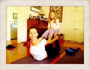Aria and daughter in Dhanurasana and Dandasana